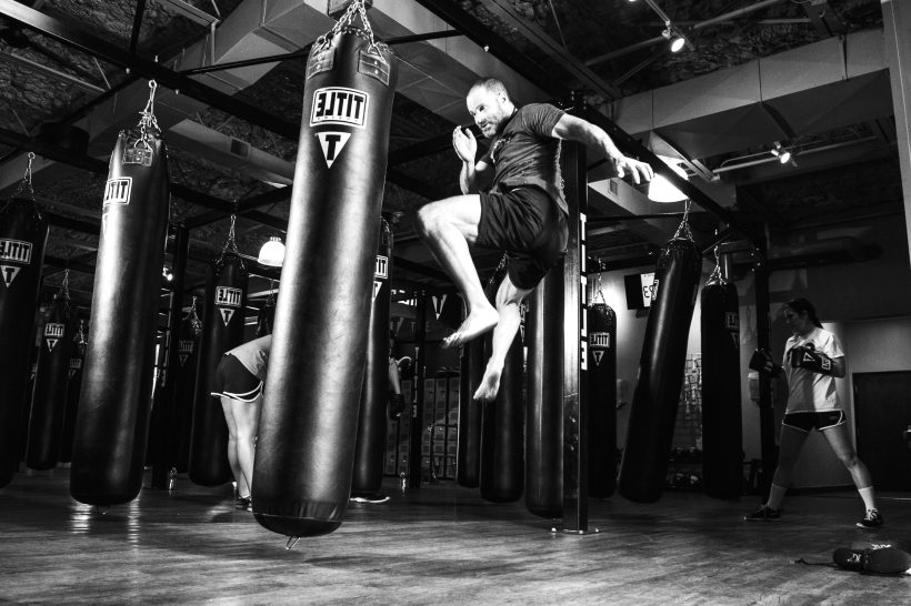 Man jumping and ready to strike the punching bag.