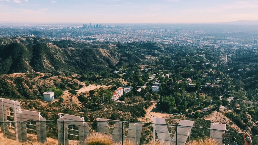 View from behind the Hollywood sign overlooking the Hollywood hills and downtown LA